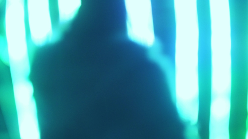 Abstract background people silhouettes moving over blurred colorful neon lines party background. | Shutterstock HD Video #1035605366