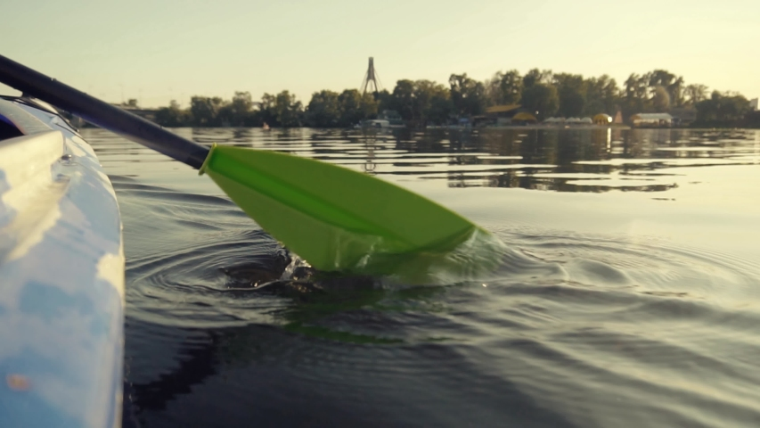 Kayak Oar Paddle Rowing In Sunrise,Backside Shot.Paddle Rowing On A Quiet River At Sunset In Slow Motion.Athlete Swimming On Canoe At Sunset Time On Tranquil River.Man In Life West Rowing On Lake. | Shutterstock HD Video #1035660386