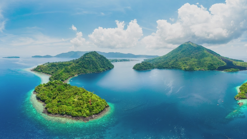 Aerial panoramic view of Banda Islands the nutmeg islands in the Moluccas archipelago, East Indonesia, Api volcano, lava flows, coral reef. Travel destination for diving snorkeling. | Shutterstock HD Video #1035903266