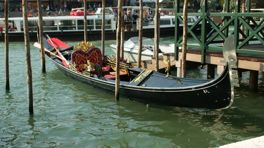 The gondola is parked on the Grand Canal, a walk on the gondola | Shutterstock HD Video #1035910406