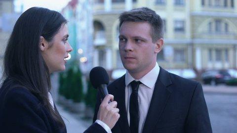 News journalist interviewing worried politician refusing answering, going away