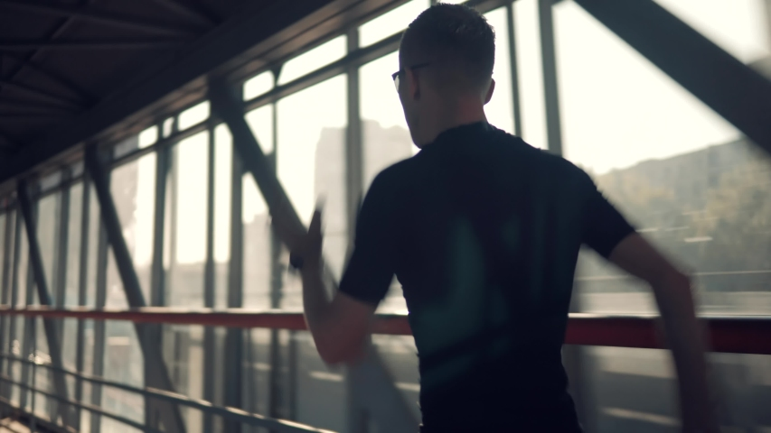 Running Man In Sportswear Workout Before Triathlon , Sprinting In Glass Tunnel.Triathlete Ready For Marathon Hard Training After Running Race Competition.Runner Athlete Jogging At Sunset.Sport Concept | Shutterstock HD Video #1036069556