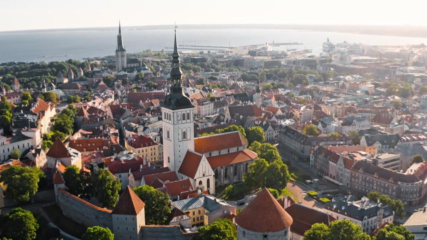 Tallinn, Estonia: morning drone view of Walls of Tallinn and St. Nicholas' Church in old town | Shutterstock HD Video #1036157276