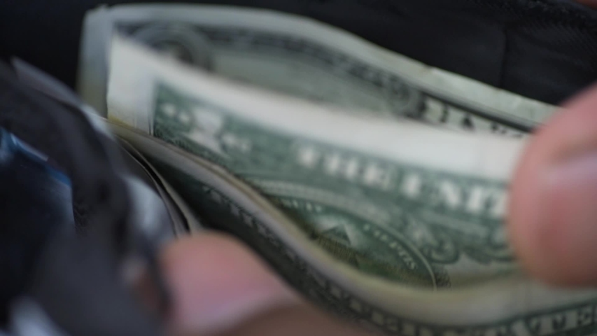 African american man counting money in wallet | Shutterstock HD Video #1036378556