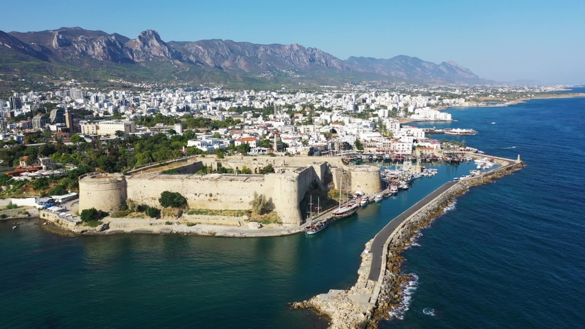 Kyrenia (Girne) is a city on the north coast of Cyprus, known for its cobblestoned old town and horseshoe-shaped harbor. | Shutterstock HD Video #1036395356