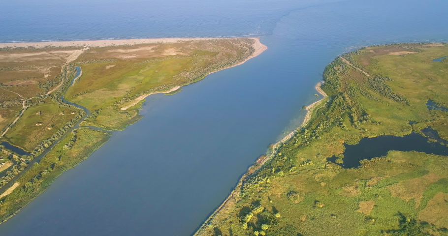 Aerial View of Danube River Mouth Flowing into the Black Sea, Sfantu Gheorghe, Romania | Shutterstock HD Video #1036409846