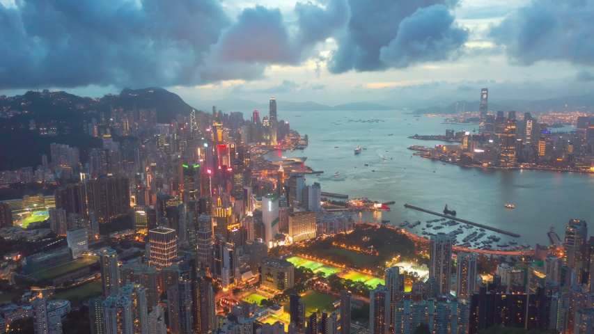 Aerial drone hyper lapse or time lapse over Hong Kong at night. Central distinct of Hong Kong shot by 4K resolution drone, Victoria Harbor, Hong Kong