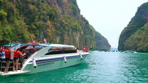 PHIPHI LEH, THAILAND - APRIL 27, 2019: The tourists enjoy swimming and snorkeling in waters of emerald Pileh Bay lagoon of Phi Phi Leh Island, lined with limestone cliffs, on April 27 in PhiPhi Leh