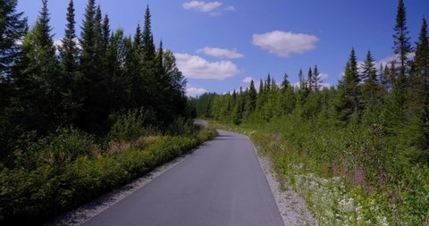 Amos, Québec/Canada 08-24-2019: A hiking and biking trail in the Abitibi forest