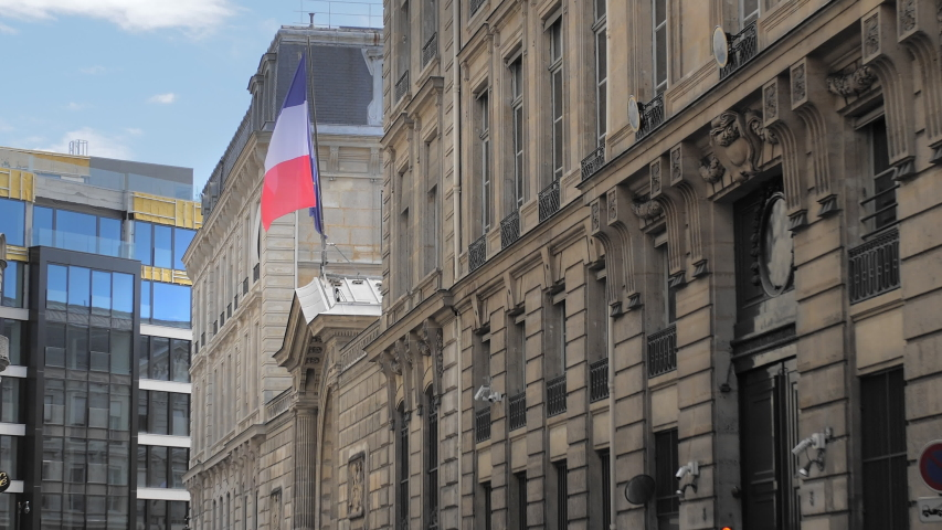 Flag of France and the European Union waves in the wind of a historic building against the backdrop of a modern building. Slow Motion. | Shutterstock HD Video #1037140136