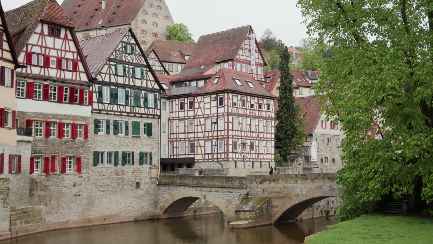 Fortress wall and Sandsteinbrucke bridge or Steinerner Steg. Half-timbered architecture. Schwabisch Hall. Germany | Shutterstock HD Video #1037142776
