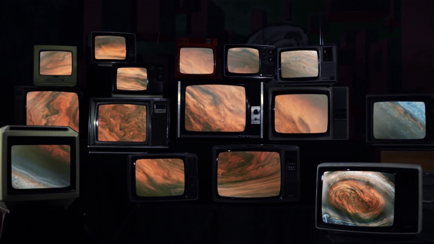 The Great Red Spot, an Ancient Storm in the Atmosphere of Jupiter, in Multi Screen.  Blue Dark Tone. Elements of this video furnished by NASA.  | Shutterstock HD Video #1037145356