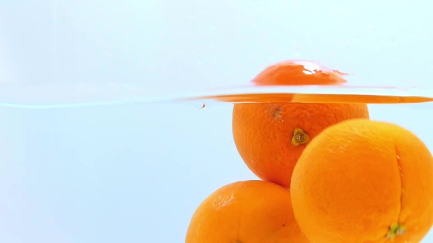 Oranges floating in the water. | Shutterstock HD Video #1037170856