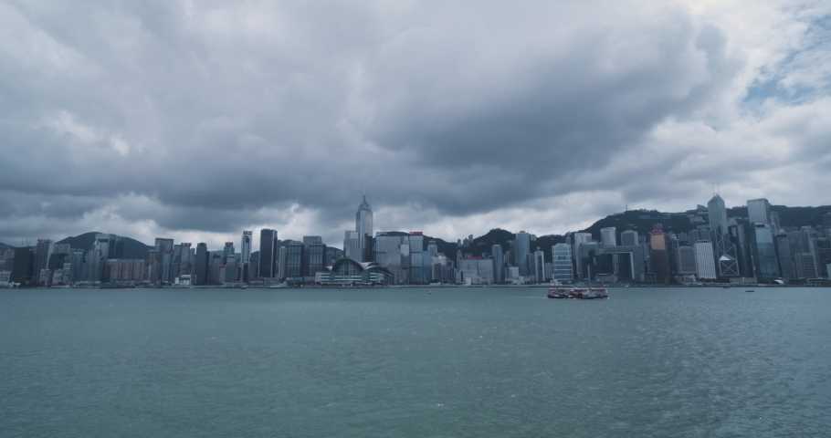Hong Kong skyline cityscape downtown over Victoria Harbour with clouds | Shutterstock HD Video #1037229656