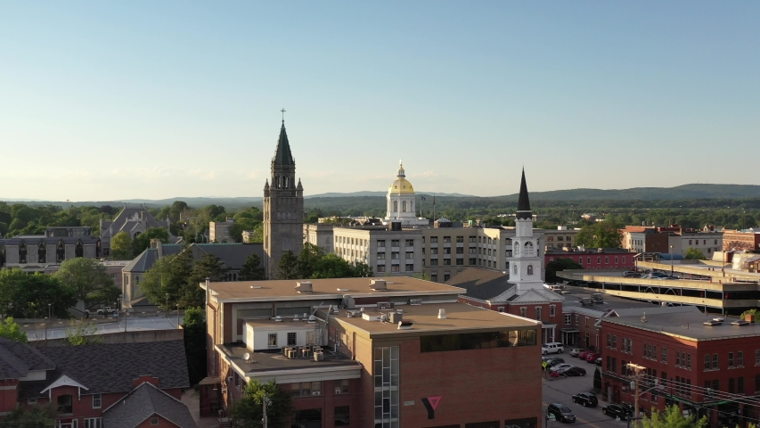 Concord, New Hampshire, USA: Aerial drone footage of city skyline with State House gold dome roof
