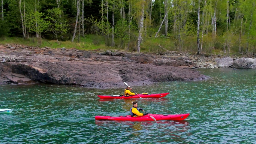 Three Kayakers on Lake Next to Forest, Trees, Kayaking 4K Aerial Drone | Shutterstock HD Video #1037304416