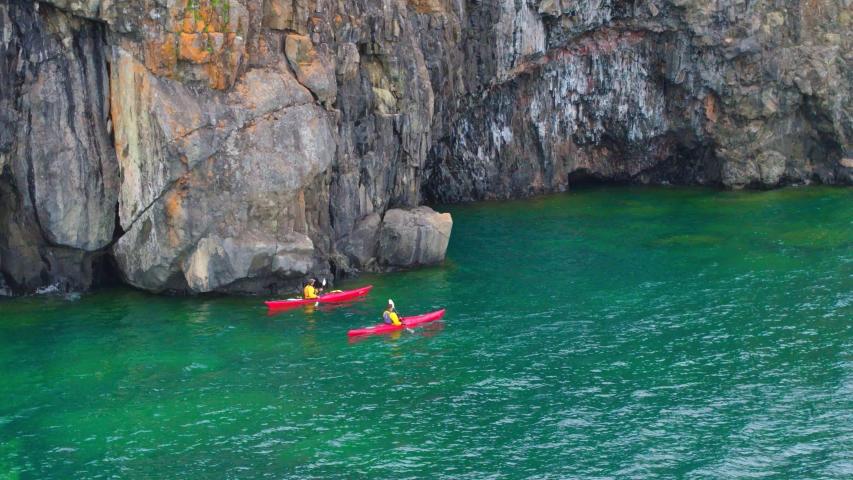 Kayaking Through Rocky Water, Cliffs, Aerial Drone | Shutterstock HD Video #1037304446
