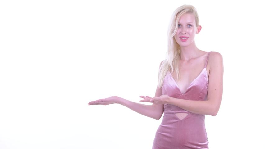 Happy young beautiful blonde woman showing something | Shutterstock HD Video #1037313206