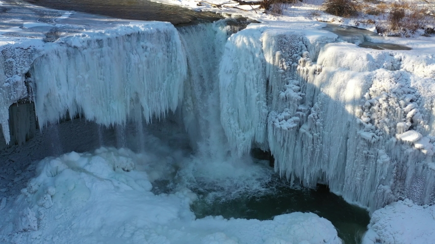 Waterfall frozen in winter aerial shot in Upstate New York | Shutterstock HD Video #1037315126
