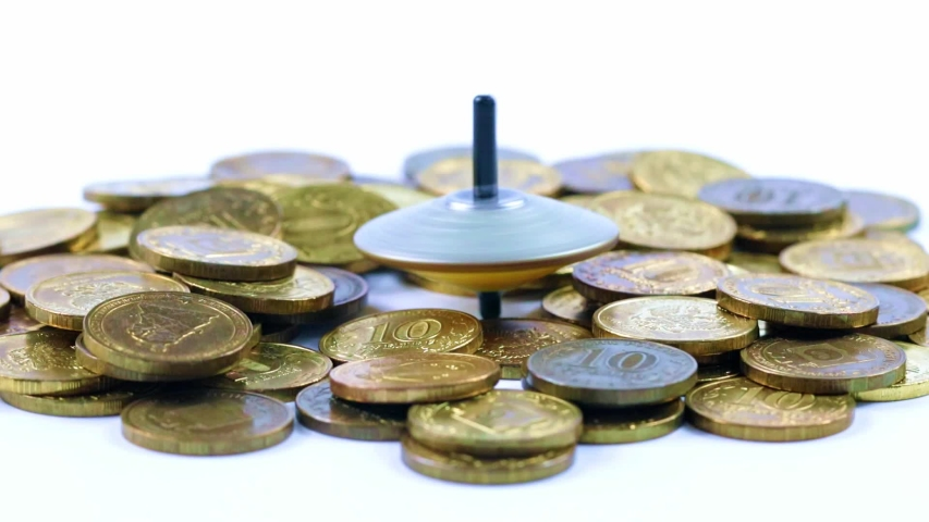 Plastic spinning top and metal coins   Shutterstock HD Video #1037389016