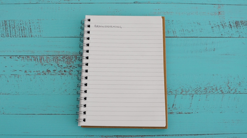 Progress bar icon placed on top of notebook with empty page titled Brainstorming, concept of coming up with new solutions and ideas | Shutterstock HD Video #1037393936