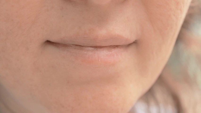 Woman mouth close up. Eating food outside in a park. Fingers bring sweet popcorn to your mouth. | Shutterstock HD Video #1037428166