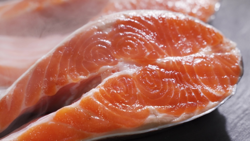 Salmon. Raw Trout Red Fish Steak rotated on slate. #1037769266