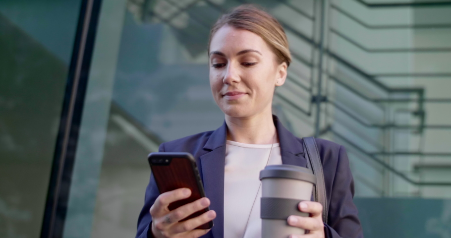 Businesswoman in suit using mobile cellphone app for ride share, hailing driver car service modern lifestyle | Shutterstock HD Video #1037804126