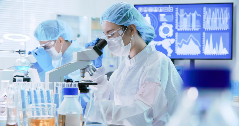 Asian scientist team has researching in the laboratory | Shutterstock HD Video #1038347696