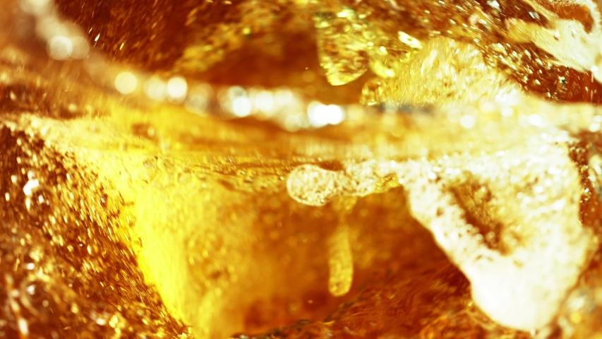 Super slow motion of pouring oil, cola or spirit drink in twister shape. Filmed on high speed cinema camera, 1000 fps. #1038459026