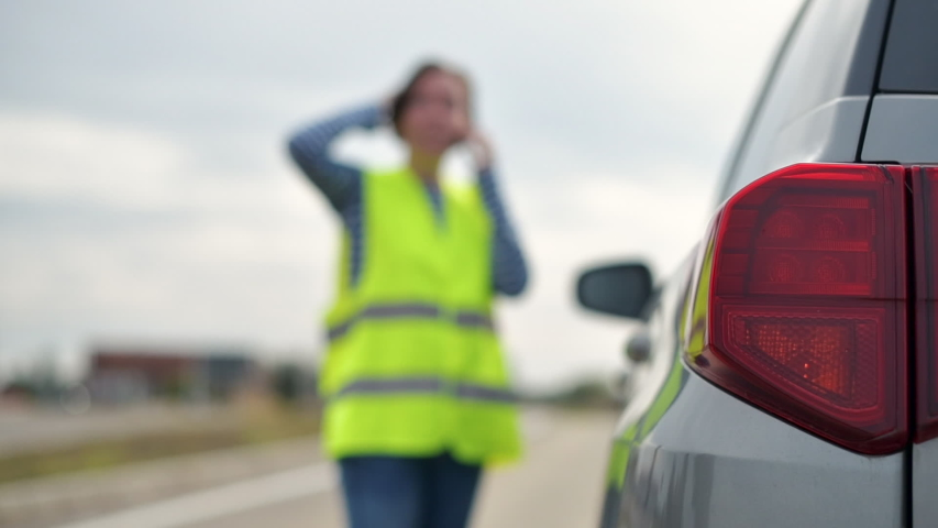 Vehicle breakdown on the road, woman using phone to ask for help and assistance | Shutterstock HD Video #1038531146