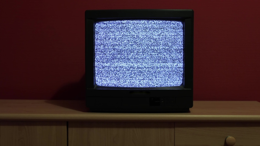 No signal just noise on an old TV set in room with red wall | Shutterstock HD Video #1038531716