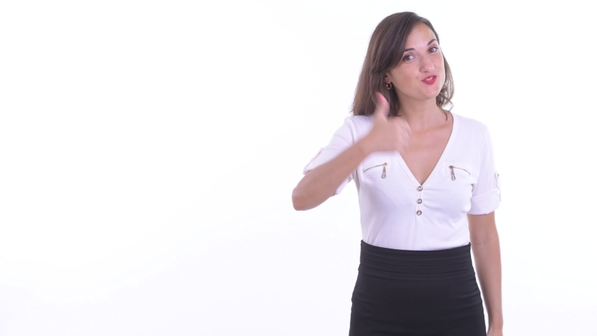 Happy beautiful businesswoman talking while showing to the back | Shutterstock HD Video #1038534056