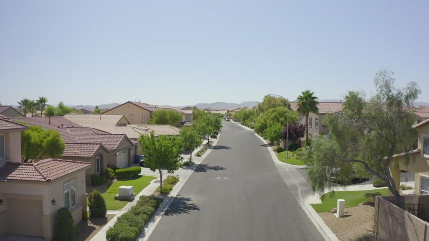 Las Vegas, Nevada suburban neighborhood fly by   Shutterstock HD Video #1038569846