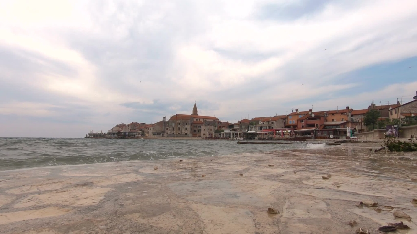 Stormy weather at umag city quay in croatia | Shutterstock HD Video #1038578576