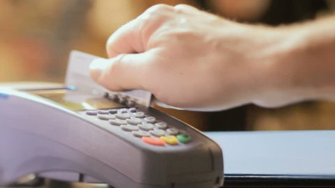 Credit card sale transaction, swiping card through terminal machine
