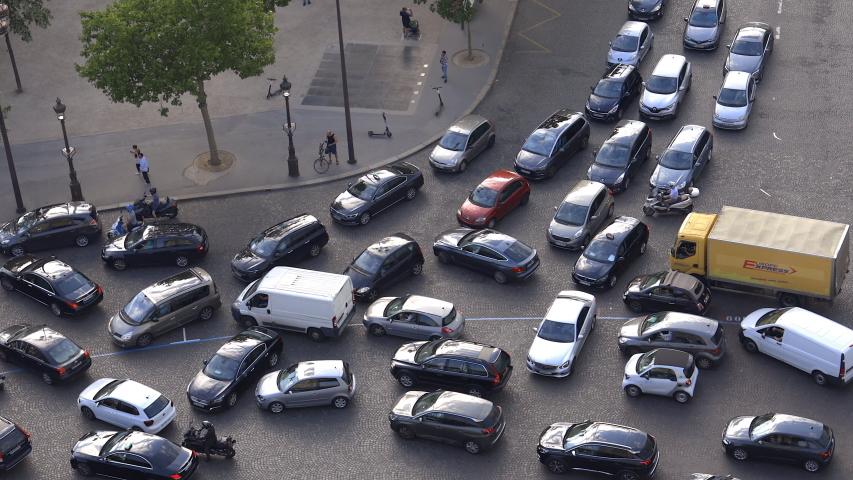 Paris, France - July 2019 : Cars stuck in traffic jam on the Place de l'Etoile near Arc de Triomphe in Paris
