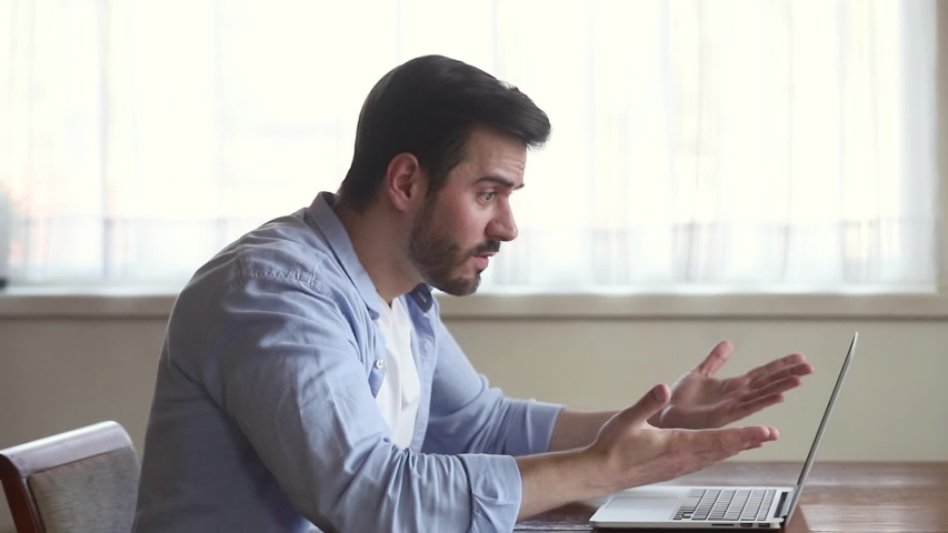 Stressed businessman sit at desk typing e-mail use pc feels irritated yelling gesticulating with angry face expression, unsuccessful results of work unsaved information lost network connection concept | Shutterstock HD Video #1038796136