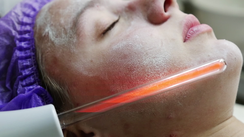 Young woman getting IPL and laser treatment by beautician at beauty clinic | Shutterstock HD Video #1038804956