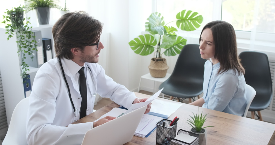 Woman consulting with doctor and leaving clinic | Shutterstock HD Video #1038813536
