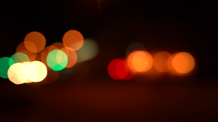 Blurred bokeh traffic on the road at night in a big city. | Shutterstock HD Video #1038939926
