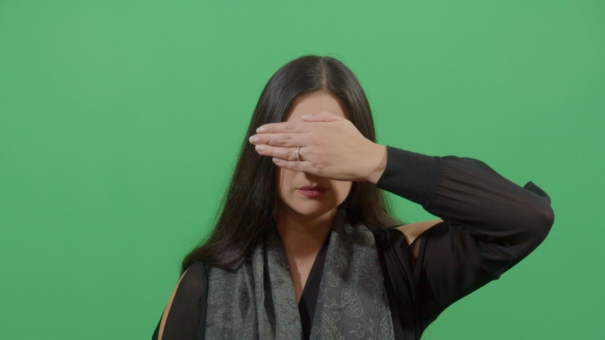 Person Doing A Gesture With Her Hand Like I Do Not Want To See. Studio Isolated Shot Against Green Screen Background | Shutterstock HD Video #1039151006