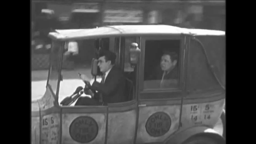 CIRCA 1920s - A reckless New York City taxi driver drives a customer in 1928