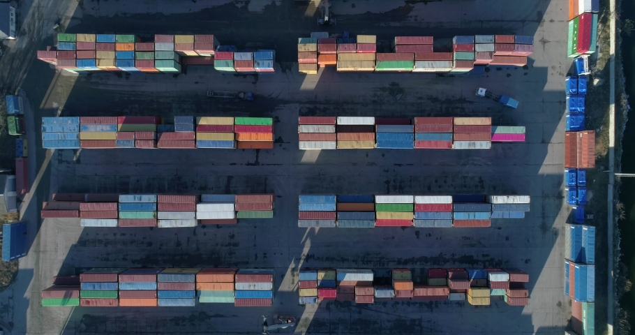 4K top down view of port container terminal. Industrial cargo harbor   Shutterstock HD Video #1039649276