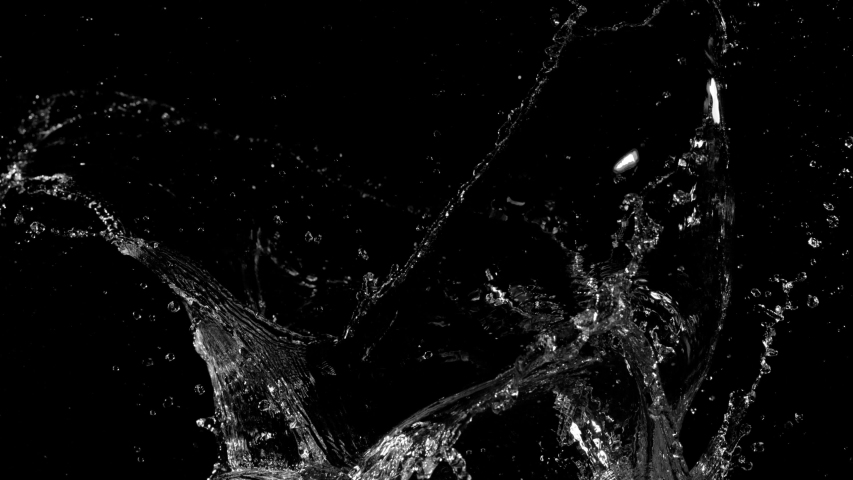 Super slow motion of splashing water isolated on black background. Filmed on very high speed cinema camera, 1000 fps. #1039801046