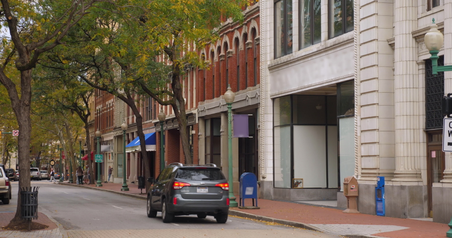 A daytime overcast establishing shot of a street corner in the Capitol Street business district in downtown Charleston, West Virginia on an Autumn day.  	 | Shutterstock HD Video #1039872656