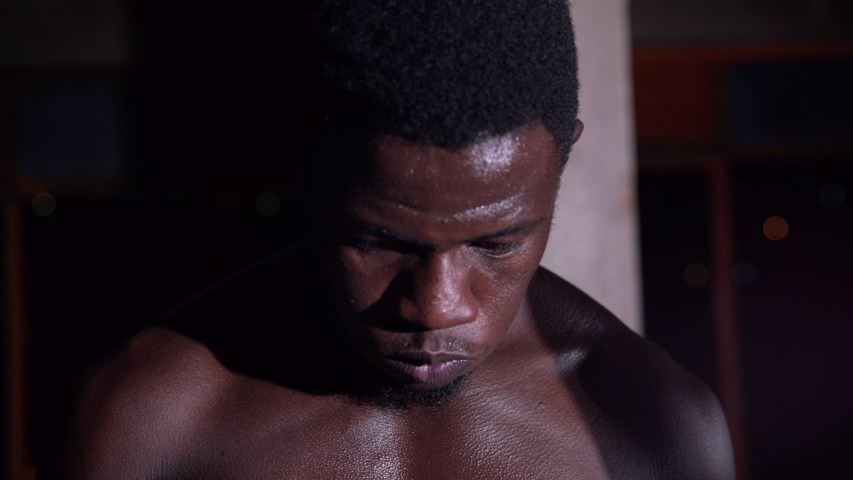 Close Up Portrait Of Man Boxer At Boxing gym in the warehouse  | Shutterstock HD Video #1039891136