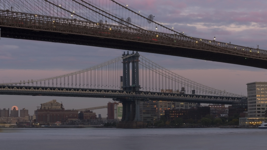 Moon rise time-lapse form East river with Manhattan And Brooklyn bridge day to night . | Shutterstock HD Video #1039942016