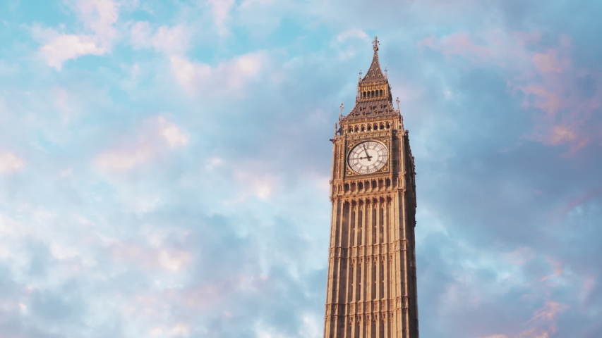 Timelapse view of the famous London landmark and travel destination - The Big Ben clocktower. Morning clouds moving by fast.  Relevant to coronavirus, covid-19, sars-cov-2 corona virus viral outbreak.   Shutterstock HD Video #1040121056