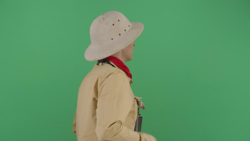 Adult Man Explorer Watching Through Binoculars To The Green Screen . Studio Isolated Shot Against Green Screen Background | Shutterstock HD Video #1040502116